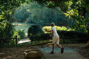 Young player throwing tee shot at Winthrop Gold Disc Golf Course