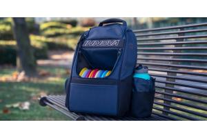 Innova disc golf bag on bench