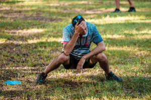 Simon Lizotte showing frustration after a bad disc golf throw