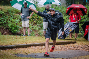 Team Innova player Ricky Wysocki throwing drive in the rain at USDGC.