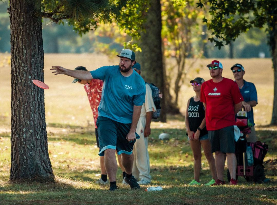 Disc golfer throwing an approach shot
